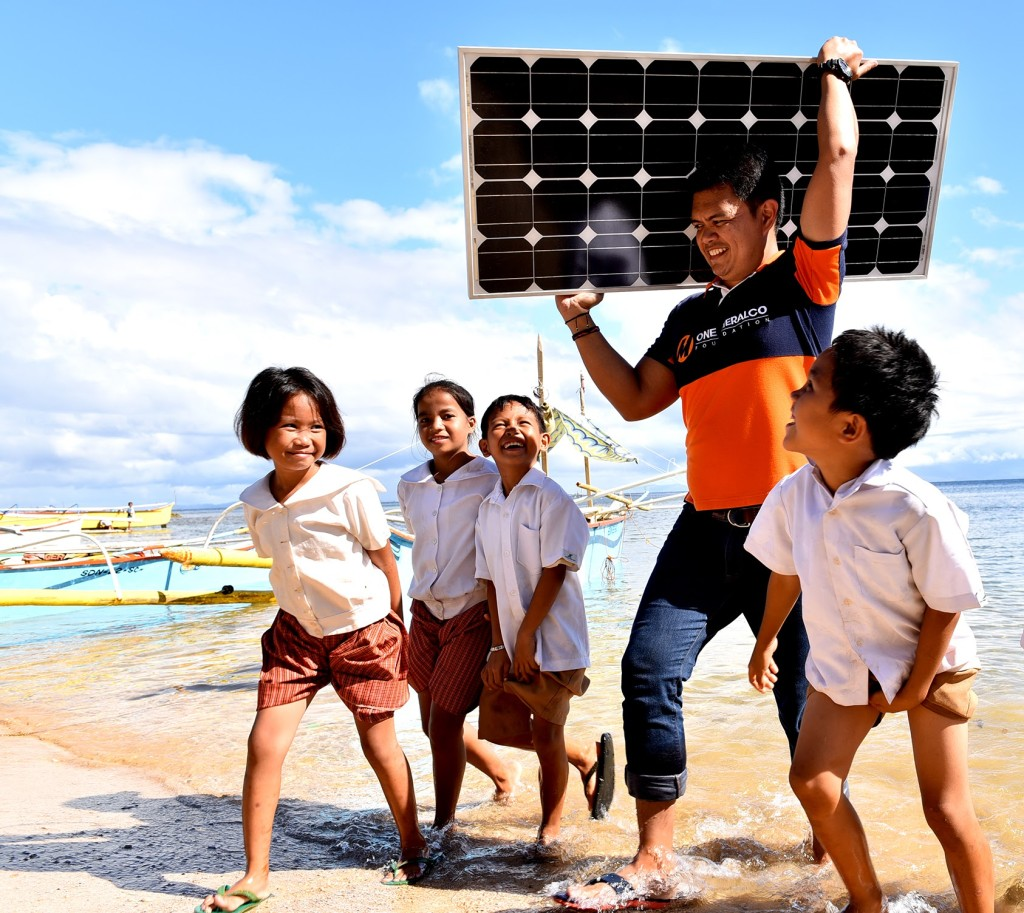 Students in Hinatuan Island, Surigao del Norte welcome the arrival of one of the solar panels which will provide power to their school.