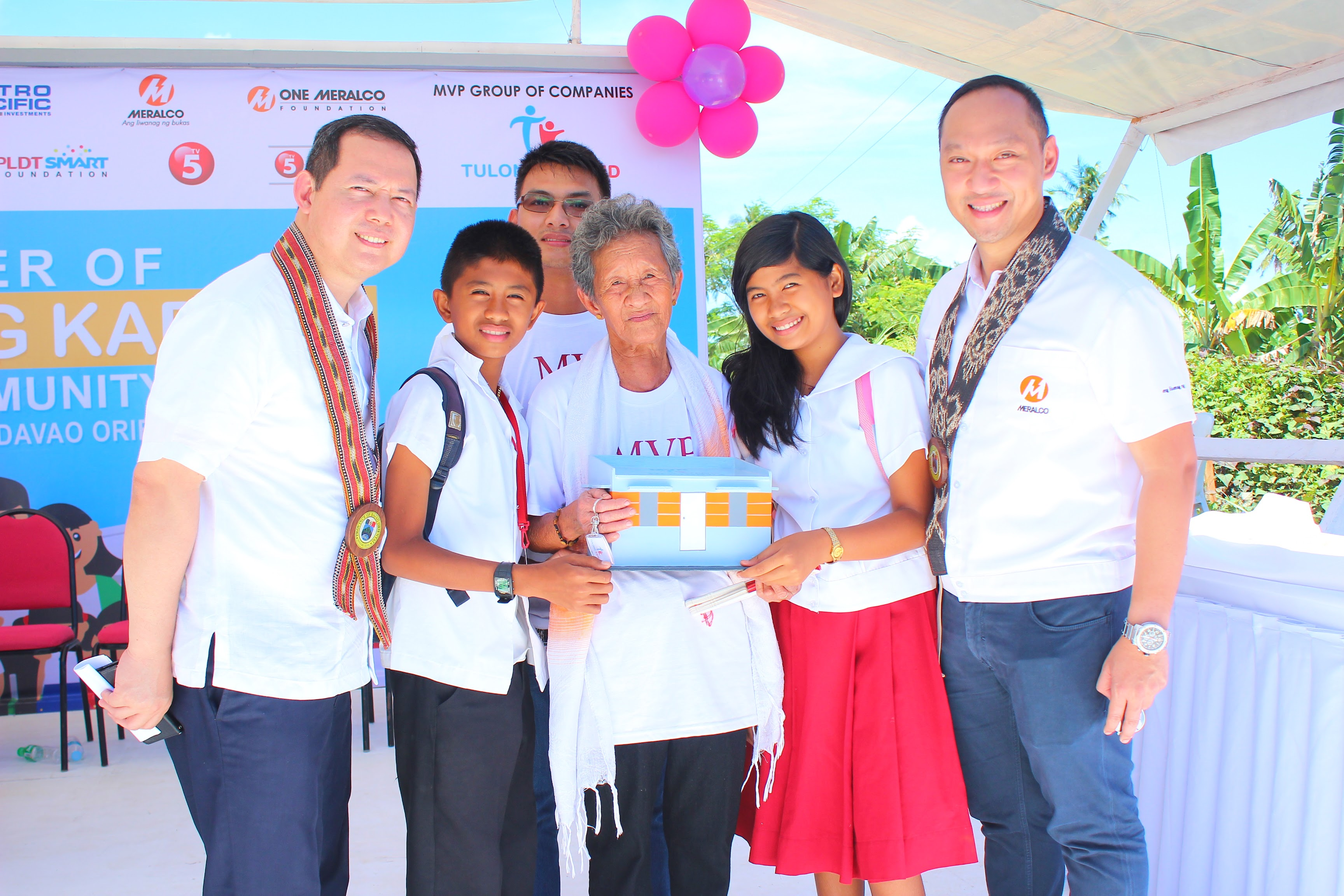 Atty. William S. Pamintuan (left), Meralco First Vice President and Head, Legal; and Jeffrey O. Tarayao (right), President of One Meralco Foundation and Chief CSR Officer of Meralco represented the company during the turnover ceremonies of the MVP Tulong Kapatid Homes in Brgy. Lambajon, Baganga, Davao Oriental. Meralco helped the Davao Electric Cooperative (DORECO) restore electrical facilities in 2012 after Typhoon Pablo knocked down poles and transmission lines in the municipalities of Cateel, Boston and Baganga. The foundation funded the extension of DORECO's electrical facilities to reach the new homes of the typhoon victims.