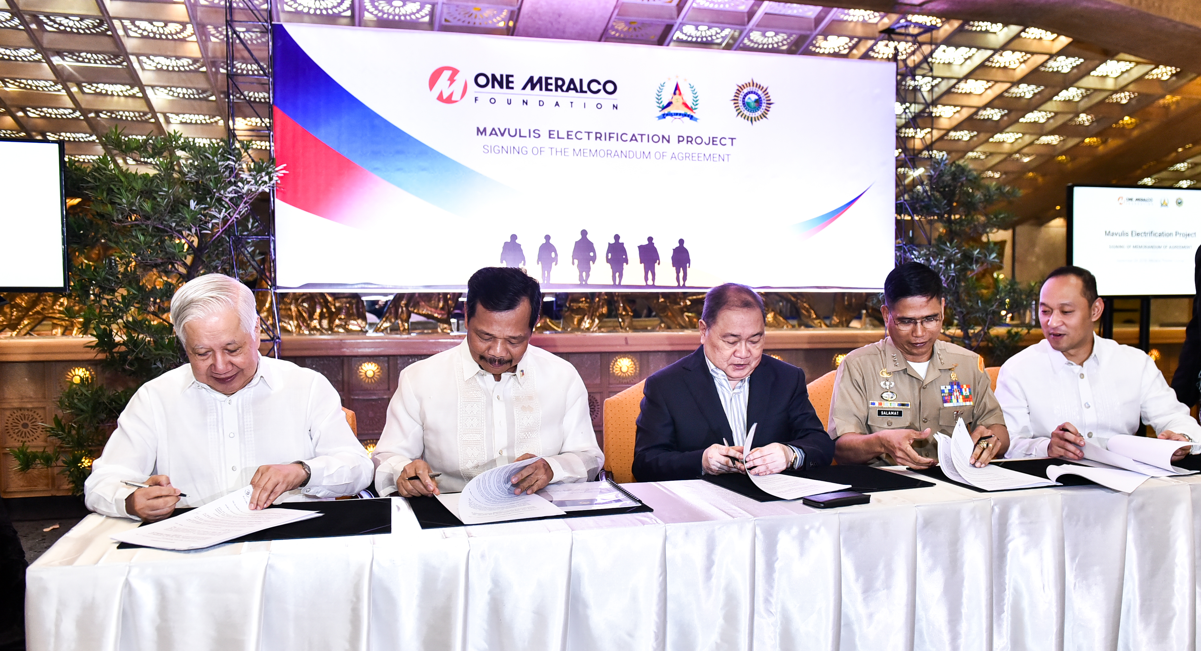 One Meralco Foundation and the Armed Forces of the Philippines seal their commitment to energize a fishermen's shelter which the military is building on Mavulis Island, the northernmost isle of Batanes.
