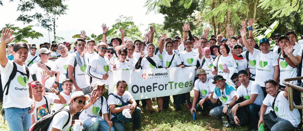 Meralco employees plant trees at the GreenEarth Heritage Farm in San Miguel, Bulacan.
