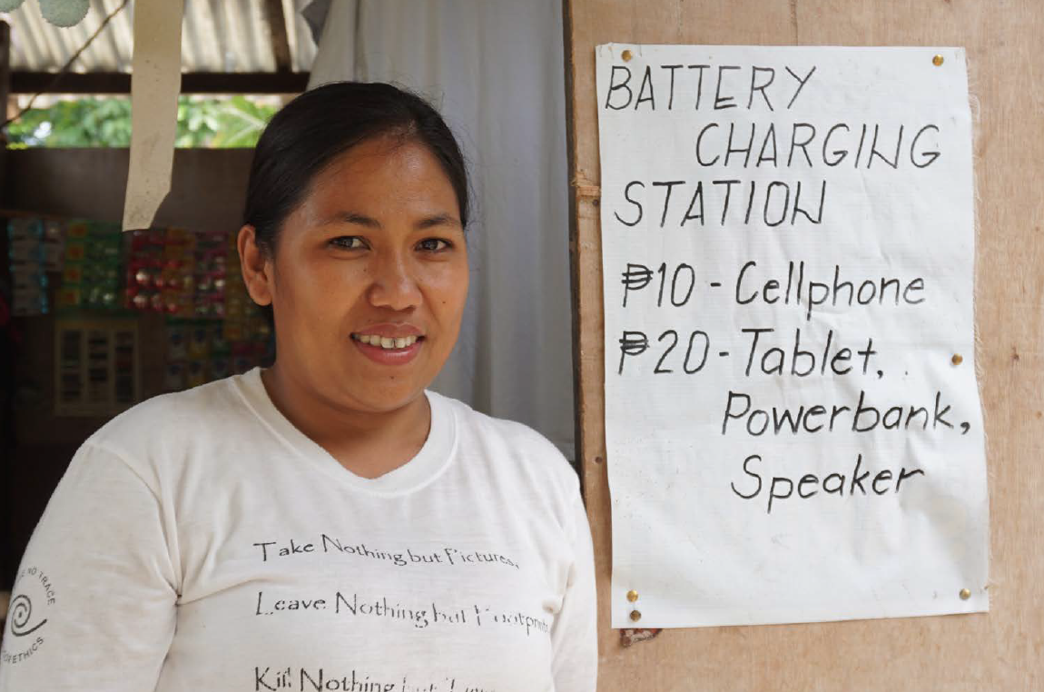 Eva Ocampo has opened a small store that also offers battery charging service to augment her family's income.