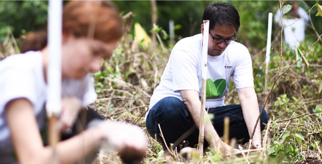 Employee-volunteers plant trees at the Green Earth Heritage Farm in San Miguel, Bulacan.